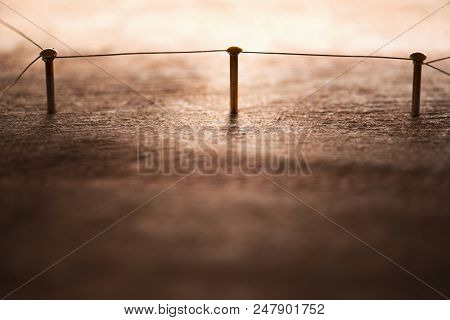 Linking entities. Network, networking, social media, internet communication abstract. Entities connected to by a wire representing a  network. gold wires on rustic wood.