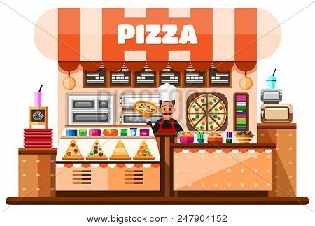 Pizza House Interior With Italian Pizzaiolo Holding Hot Pizza And Standing Behind Of Desks Counter W