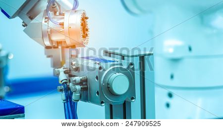 Robot Hand Machine Gripping Simulated  Object On Blurred Background. Use Smart Robot In Manufacturin