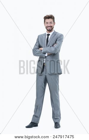 Confident successful businessman in gray suit on white backgroun