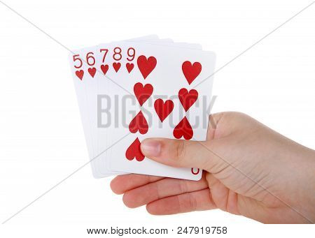 Young female hand holding Playing cards, a straight flush. A straight flush is a five card sequence of the same suit. hearts. poster
