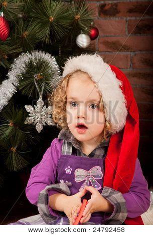 Beautiful girl near fir-tree