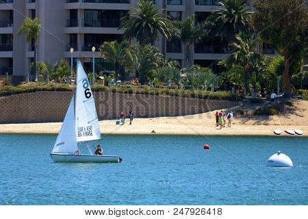 July 2, 2018, In Newport Beach, Ca:  People Sailing In A Small Sail Boat Called A Dinghy Boat Taken