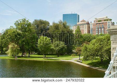 Scenic Views Of The Boston Skyline In The Boston Public Garden In Boston, Massachusetts.