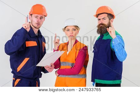Men In Hard Hats, Uniform And Woman. Builder And Engineer Found Out How To Solve Problem. Team Of Ar