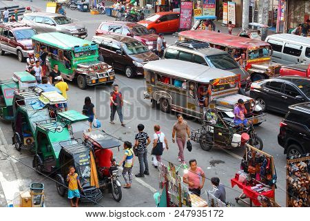 Manila, Philippines - November 25, 2017: People Drive In Heavy Traffic In Manila, Philippines. Metro