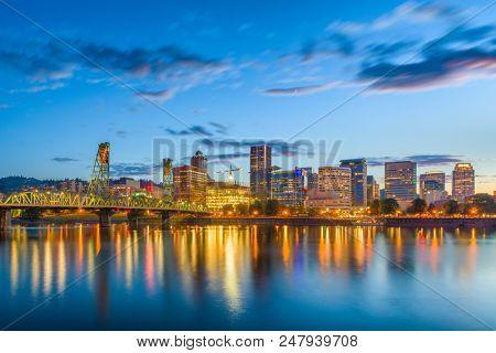 Portland, Oregon, USA skyline at dusk on the Willamette River.