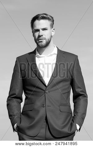 Business Man. Fashion Style Lifestyle. Businessman Stand On Blue Sky, Success. Man In Business Suit