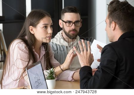 Angry Millennial Couple Argue With Realtor Or Broker Dissatisfied With House Project, Spouses Disput
