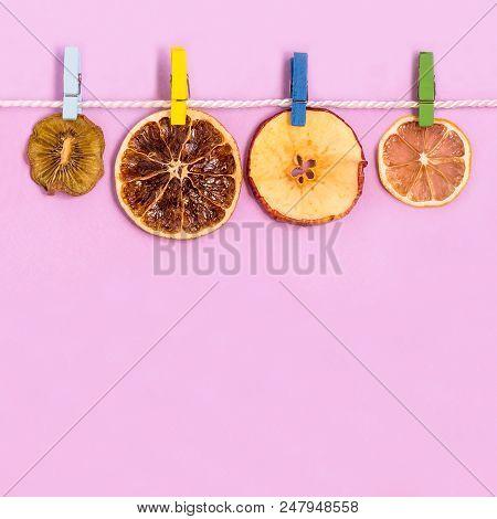 Slices Of Fruit (kiwi, Grapefruit, Apple, Lemon) Dried On Rope With Clothespins. Creative Idea, Imag