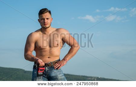 Athletic Training. Athletic Man With Muscular Torso On Blue Sky. Sportsman With Athletic Equipment O