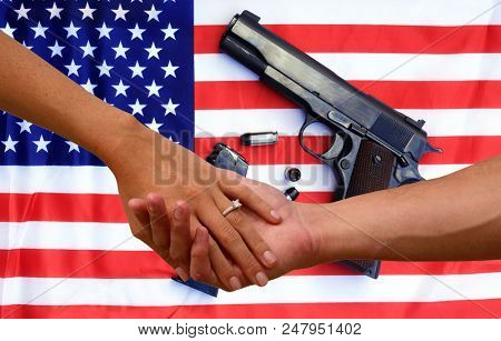 2nd amendment love. a couple holds hands with an American flag and hand gun background. Second Amendment.