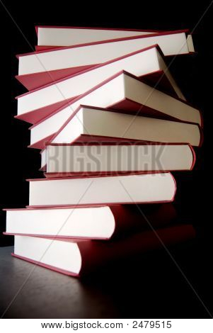 Books Stacked Up Over Black