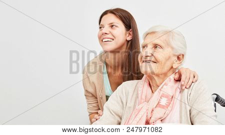 Young woman and senior woman are smiling and hopeful looking to the future
