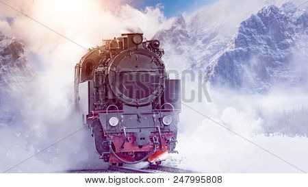 steam powered locomotive dashing through scenic mountains