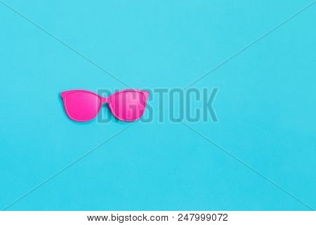 Pink Glasses On Blue Background. Minimal Concept. Creative Concept. Hot Summer. Pop Art. Bright Swee