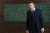 Talented mathematician. Man formal wear classic suit looks smart, chalkboard with equations background. Genius solved mathematics problem. Teacher smart student intrested math physics exact sciences. poster