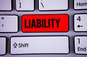 Conceptual hand writing showing Liability. Business photo text State of being legally responsible for something Responsibility Keyboard office typing work click assign button computer program poster
