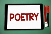 Conceptual hand writing showing Poetry. Business photo showcasing Literary work Expression of feelings ideas with rhythm Poems writing Wide framed white tablet board smart screen pen cap learn poster