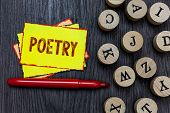 Writing note showing Poetry. Business photo showcasing Literary work Expression of feelings ideas with rhythm Poems writing Multiple small sticky cards wood alphabet button pen grey background poster