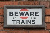 Beware of the Trains Sign - wringing of danger of trains poster