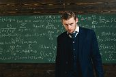 Talented mathematician. Genius solved mathematics problem.Teacher smart student intrested math physics exact sciences. Man formal wear classic suit looks smart, chalkboard with equations background. poster