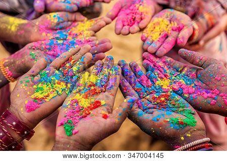 Color Holi Festival. Colourful Hand With Happy Holi Powder. Happy Holi Background.