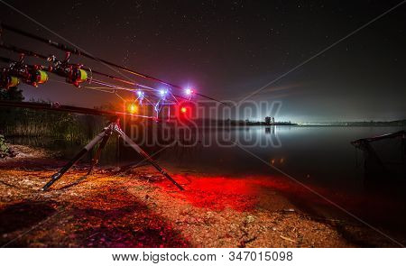 Carp Fishing Angling At Lake At Night With Illuminated Alarms. Night Fishing, Carp Rods, Close Up Fi