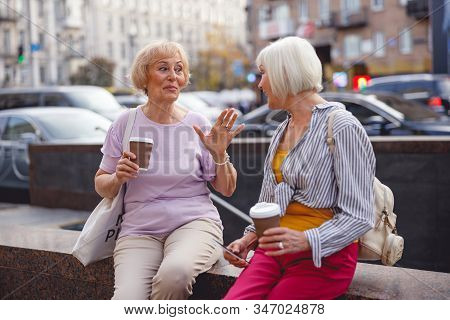 Woman Telling Her Friend A Hilarious Story
