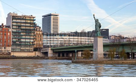 The Statue Of Liberty On The Island Cygnes In Paris, France.