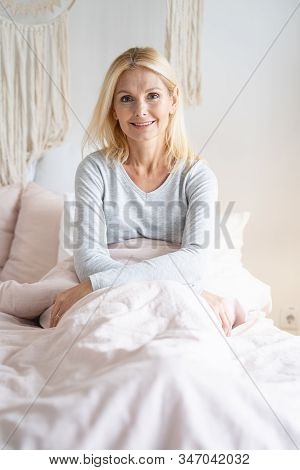 Mirthful Lady In Her Bed Stock Photo