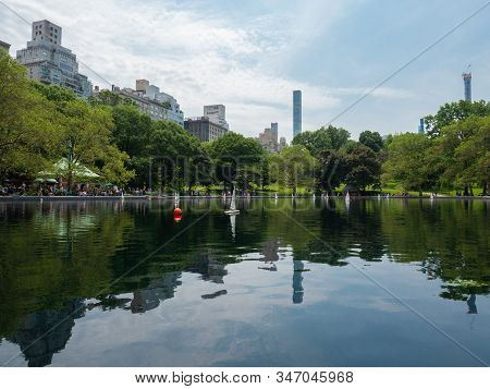 New York, Usa - June 2, 2019: Low Angle Image Of The Conservatory Water Pond In Central Park.
