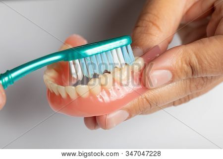 Clean Dental Prothesis With Toothbrush
