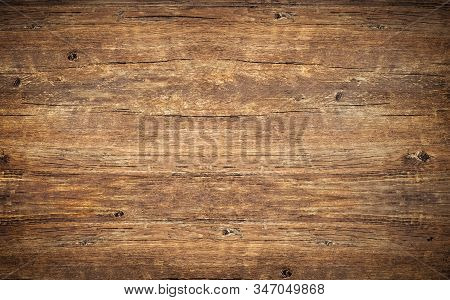 Wood Texture Background. Top View Of Vintage Wooden Table With Cracks. Surface Of Old Knotted Wood W