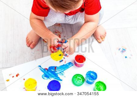 Baby Drawing  Multi-colored Finger Paints. Flat Lay. Artwork