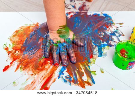 Children's Hand In Paints. Finger Paints. Baby Artwork . Flat Lay