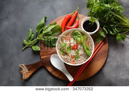 Traditional Vietnamese Soup Pho Bo With Herbs,beef, Rice Noodles,chili And Bean Sprouts . Vietnamese