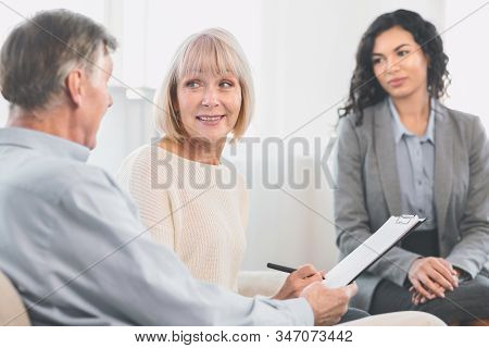 Senior Health Insurance Concept. Mature Couple Making Agreement With Sale Agent, Senior Woman Signin
