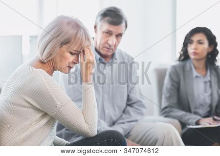 Depressed Wife. Psychologist Helping Mature Couple With Relationship Difficulties, Sad Patients List