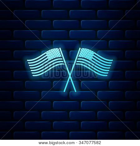 Glowing Neon Two Crossed American Waving Flags Icon Isolated On Brick Wall Background. National Flag