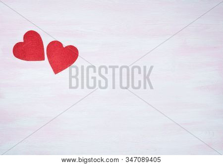 Two Red Hearts On A Lilac Wooden Background With Space For Text