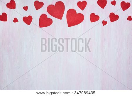 Red Hearts On A Lilac Wooden Background With Space For Text Below