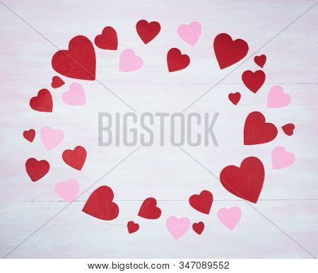 Valentines Day. Frame Of Hearts On A Lilac Wooden Background.