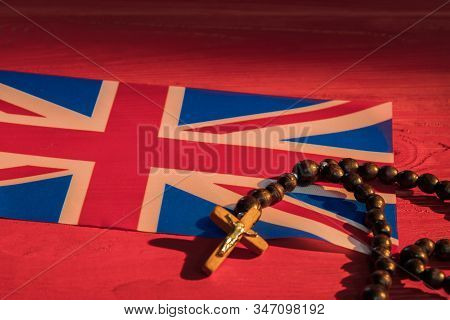 Great Britain Religion Concept. Uk Flat And Crucifix Rosary Necklace. Closeup.