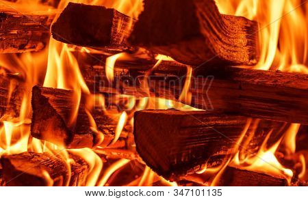 Burning Firewood In The Fireplace Close Up. Bbq Fire. Charcoal Background. Charcoal Fire With Sparks