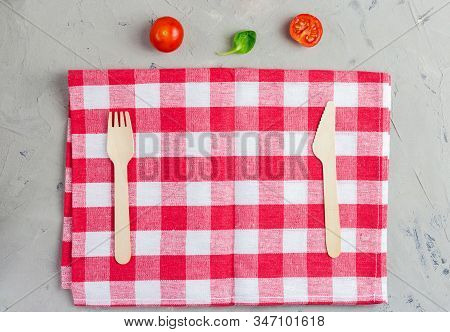 Checkered Napkin With Knife And Fork On Gray Background. Abstract Food Background With Napkin And Wo