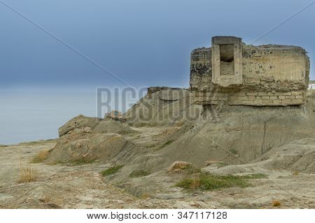 Fortifications From Second World War, Feodosia, Crimea. View Of Ruins On The Deserted Coast. Histori