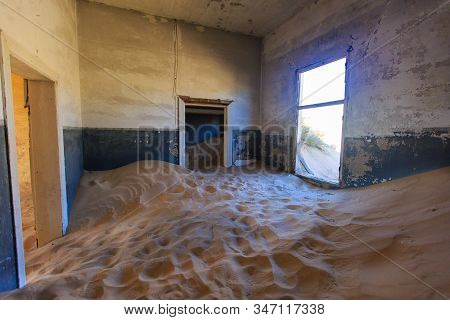 Abandoned And Forgotten Building And Room Left By People And Being Taken Over By Encroaching Sandsto