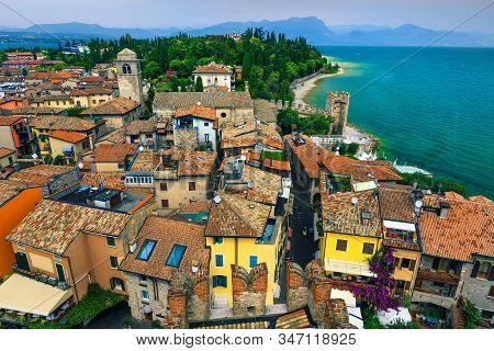 Stunning View To The Old Roofs And Touristic Streets Of Sirmione Resort From The Scaliger Castle. Be