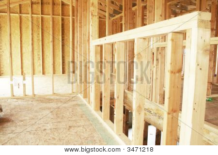 A new home under construction with frame work poster